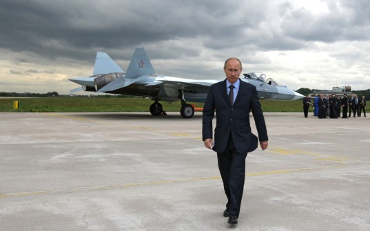 Men_Politics_Vladimir_Putin_against_a_fighter_023803_