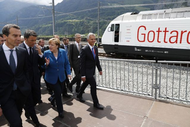 epa05340067 Swiss Federal Councillor Didier Burkhalter (R) walks next to German Chancellor Angela Merkel, Italian Prime Minister Matteo Renzi and Austrian Chancellor Christian Kern (R-L), on the opening day of the Gotthard rail tunnel, the longest tunnel in the world, at the fairground Rynaecht at the northern portal in Erstfeld, Switzerland, 01 June 2016. The construction of the 57 kilometer long tunnel began in 1999, the breakthrough was in 2010. After the official opening on 01 June, the commercial opperation will commence on December 2016. EPA/PETER KLAUNZER / POOL