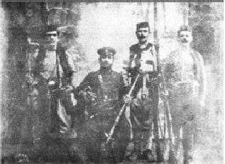 Војвода Мицко са својим четницима: У позним годинама живео је у Крагујевцу, где се око њега створионајјачи четнички центар. Мали Војин звани Туре, упијао је његове приче. Воја Туре, ући ће у историју четништва као Војвода Вук