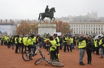 People gather to protest against fuel taxes, in Lyon, central France, Saturday, Nov. 17, 2018. France is bracing for a nationwide traffic mess as drivers plan to block roads to protest rising fuel taxes, in a new challenge to embattled President Emmanuel Macron. (AP Photo/Laurent Cipriani)