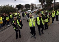 Demonstrators block a motorway exit to protest fuel taxes, in Marseille, southern France, Tuesday, Nov. 17, 2018. France is bracing for a nationwide traffic mess as drivers plan to block roads to protest rising fuel taxes, in a new challenge to embattled President Emmanuel Macron. (AP Photo/Claude Paris)